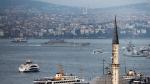 A Russian warship passes through the Bosphorus, in Istanbul, en route to the Mediterranean Sea, Tuesday, Oct. 6, 2015. (AP Photo)