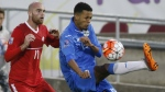 Cuba defender Adrian Diz Pe, right, clears the ball as Canada midfielder Jeremy Gagnon-Lapare covers during the second half of a CONCACAF Olympic qualifying soccer match in Commerce City, Colo. on Oct. 6, 2015. (AP / David Zalubowski)