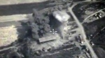 This file photo made from the footage taken from the Russian Defense Ministry official web site shows an aerial view of a bomb explosion in Syria on Oct. 4, 2015. (Russian Defence Ministry Press Service)