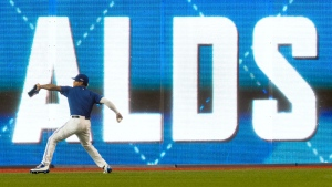 Toronto Blue Jays starting pitcher Marcus Stroman plays long-toss in front of a video board during a team workout at the Rogers Centre in Toronto on Tuesday, Oct. 6, 2015. (Darren Calabrese / THE CANADIAN PRESS)