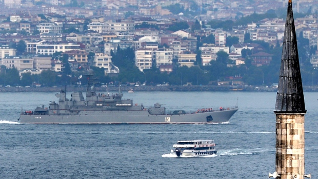 Russian warship passes through the Bosphorus, in Istanbul, en route to the Mediterranean Sea, Tuesday, Oct. 6, 2015. (AP Photo)