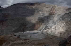 In this May 14, 2013 file photo, the open-pit Antamina mine in San Marcos, Peru, is partially illuminated on a cloudy day. (AP/Martin Mejia, File)