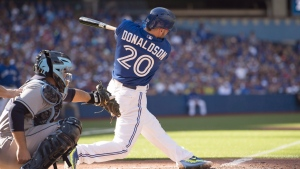Toronto Blue Jays Josh Donaldson swings through on his walk-off home run during  the final game of the regular season. The Blue Jays face the Rangers in Game of the ALDS Thursday in Toronto. (Frank Gunn / THE CANADIAN PRESS)