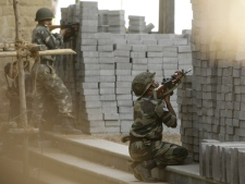 Indian army soldiers take up positions near the Taj Mahal Hotel in Mumbai, India, on Thursday, Nov. 27, 2008. (AP / Gurinder Osan)