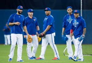 Toronto Blue Jays, from left to right, Jose Bautista, Josh Donaldson, Edwin Encarnacion, David Price, and Marcus Stroman watch batting practice during a team workout at the Rogers Centre in Toronto on October 7, 2015. (Darren Calabrese / The Canadian Press)