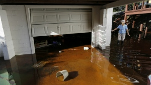 Roberta Albers walks around her home after the floodwaters start to recede at French Quarter Creek in Huger, S.C. on Oct. 7, 2015. (AP / Mic Smith)