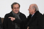 In this Dec. 16, 2014 file photo, FIFA president Sepp Blatter, right, and UEFA president Michel Platini talk in Marrakech, Morocco. (AP / Christophe Ena)
