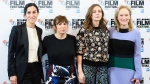 """British director Sarah Gavron, scriptwriter Abi Morgan, British actress Carey Mulligan and US actress Meryl Streep pose at a photocall prior to the premiere of """"Suffragette"""" at the London Film Festival in central London on Oct. 7, 2015. (AFP PHOTO / LEON NEAL)"""