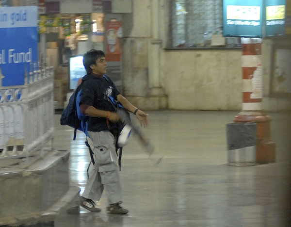 A gunman walks at the Chatrapathi Sivaji Terminal railway station in Mumbai, India, Wednesday, Nov. 26, 2008. (Mumbai Mirror / Sebastian D'souza)