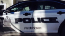 Fredericton police arrested a 26-year-old man on a Canada-wide warrant Friday.
