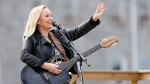 Melissa Etheridge performs for inmates at the Ohio Reformatory for Women in Marysville, Ohio, on Wednesday, Oct. 7, 2015. Etheridge says a video of female inmates singing one of her songs led to her performing with them. (Jonathan Quilter/Columbus Dispatch via AP)