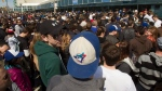 In this file photo, Toronto Blue Jays fans fill the streets as they line up for tickets prior to Jays vs Minnesota Twins AL action in Toronto on Saturday, April 2, 2011. (THE CANADIAN PRESS/Frank Gunn)