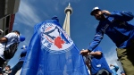 Fans arrive for game one of the Toronto Blue Jays and Texas Rangers American League Division Series in Toronto on Thursday, Oct. 8, 2015. (Nathan Denette / THE CANADIAN PRESS)