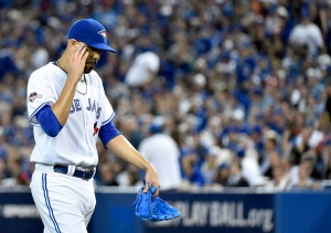Toronto Blue Jays starting pitcher David Price walks back to the dugout during seventh inning game one American League Division Series baseball action against the Texas Rangers in Toronto on Thursday, Oct. 8, 2015. (Nathan Denette / THE CANADIAN PRESS)