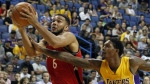 Toronto Raptors guard Cory Joseph drives past Los Angeles Lakers guard Louis Williams during the second half of an NBA pre-season basketball game in Ontario, Calif., Thursday, Oct. 8, 2015. (AP / Alex Gallardo)