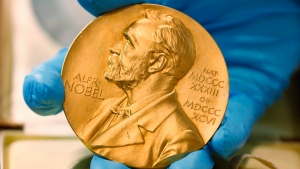 A gold Nobel Prize medal photographed on April 17, 2015 (AP / Fernando Vergara)