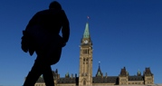 A man walks on Parliament Hill on September 15, 2014. (Sean Kilpatrick / THE CANADIAN PRESS)
