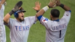 Texas Rangers Rougned Odor and Elvis Andrus celebrate Odor scoring during 14th inning of Game 2 of the ALDS against the Toronto Blue Jays in Toronto on Friday, Oct. 9, 2015. (Darren Calabrese / THE CANADIAN PRESS)