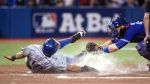 Toronto Blue Jays' catcher Russell Martin, right, misses the tag on Texas Rangers' Rougned Odor as he scores on a sacrifice fly by Hanser Alberto in Toronto on Oct. 9, 2015. (Frank Gunn / The Canadian Press)