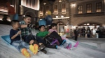 Children laugh and scream while sledding at Snow Town in Bangkok. (AFP PHOTO / Nicolas ASFOURI)