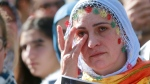 A Kurdish demonstrator in Paris, cries as she and others gather after an explosion at a rally in Ankara, Turkey, Saturday, Oct. 10, 2015. (AP Photo/Jacques Brinon)