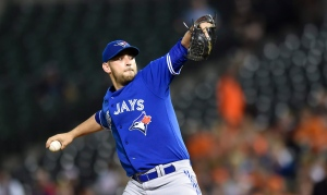 Toronto Blue Jays starting pitcher Marco Estrada delivers against the Baltimore Orioles in the first inning of a baseball game, Monday, Sept. 28, 2015, in Baltimore. (AP/Gail Burton)