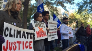 Protesters hold signs at the starting point for a demonstration against pipelines in Montreal Saturday, Oct. 10 2015. (Kevin Gallagher/CTV Montreal)