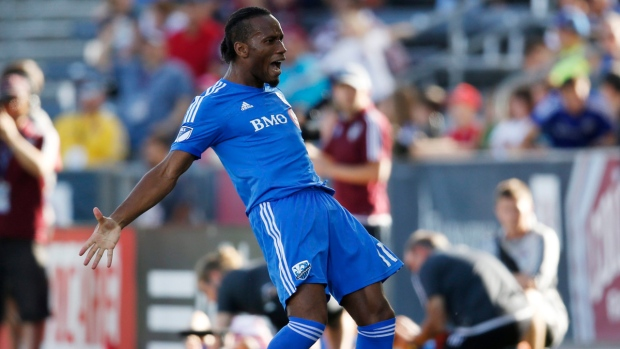 Didier Drogba celebrates after freekick