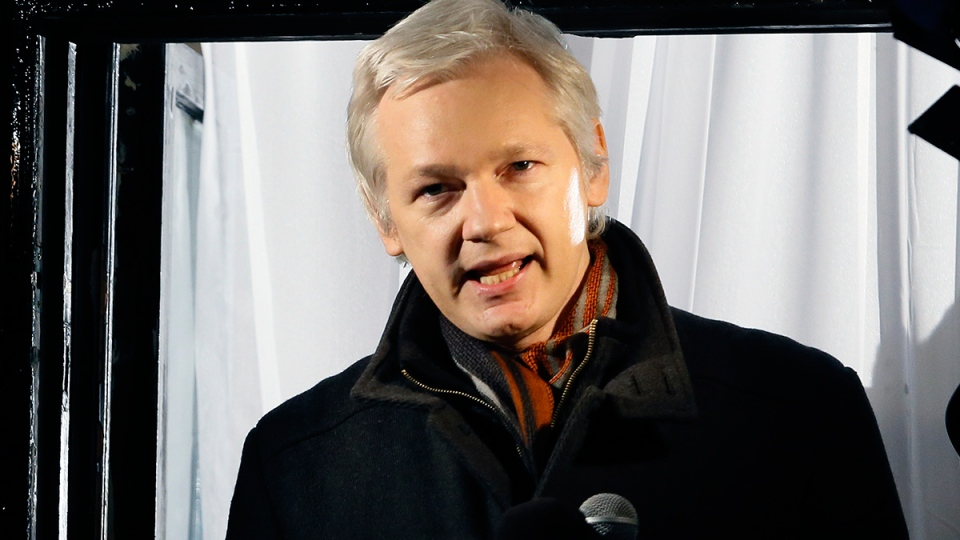 Julian Assange, founder of WikiLeaks speaks to the media and members of the public from a balcony at the Ecuadorian Embassy in London, Thursday, Dec. 20, 2012. (AP / Kirsty Wigglesworth)