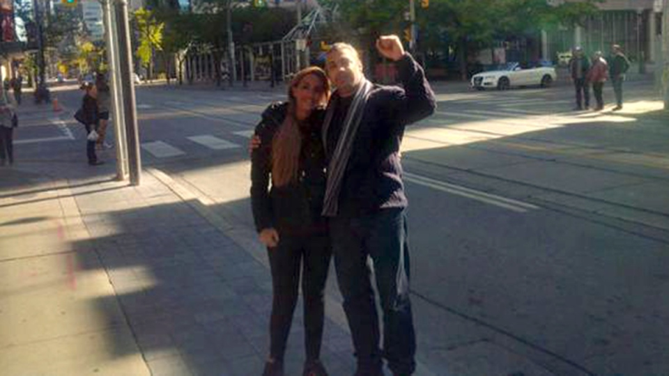 Mohamed Fahmy walks the streets of Toronto with his wife Marwa Omara, Monday, Oct. 12, 2015. (Mohamed Fahmy / Twitter)
