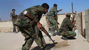 Syrian soldiers in Achan, Hama province, Syria on Sunday, Oct. 11, 2015. (Alexander Kots / Komsomolskaya Pravda)