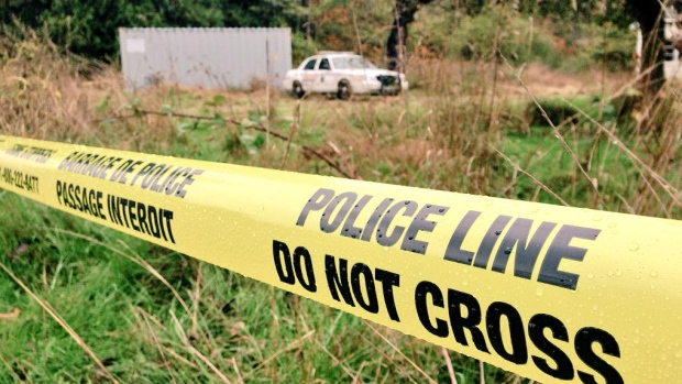 Police tape is seen on Salt Spring Island in this 2015 file photo.