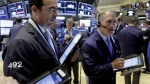 Timothy Nick, right, works with fellow traders on the floor of the New York Stock Exchange, Monday, Oct. 12, 2015. (AP / Richard Drew)