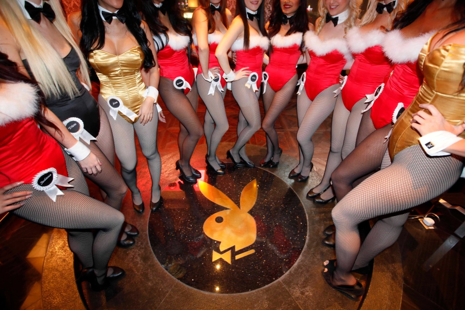 In this file photo from Dec. 18, 2010, waitresses pose inside the Playboy Club at the Sands Casino in Macau. (AP / Kin Cheung)