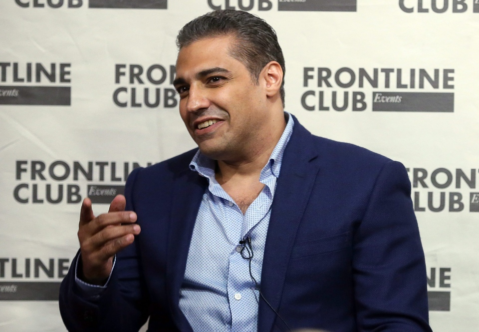 FILE - In this Wednesday Oct. 7, 2015, file photo, former Al Jazeera bureau chief Mohamed Fahmy speaks during a talk at the Frontline Club in London. Fahmy, who was released from prison in Egypt last month, has returned home to Canada with the hope of starting an election debate on how the Canadian government can better protect its citizens abroad. (AP Photo/Tim Ireland, File)