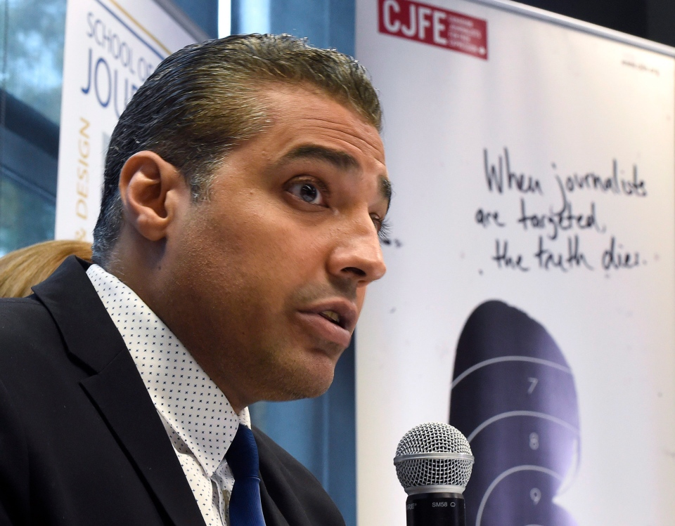 Canadian journalist Mohamed Fahmy addresses a news conference hosted by Canadian Journalists for Free Expression at Ryerson University in Toronto, Tuesday, Oct.13, 2015. (Frank Gunn / THE CANADIAN PRESS)