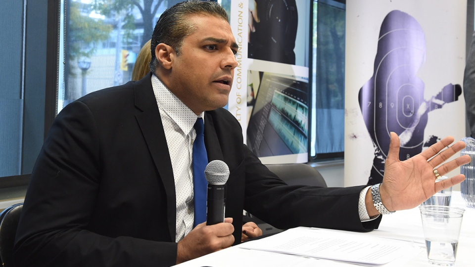 Canadian journalist Mohamed Fahmy addresses a news conference hosted by Canadian Journalists for Free Expression at Ryerson University in Toronto, Tuesday, Oct. 13, 2015. (Frank Gunn / THE CANADIAN PRESS)