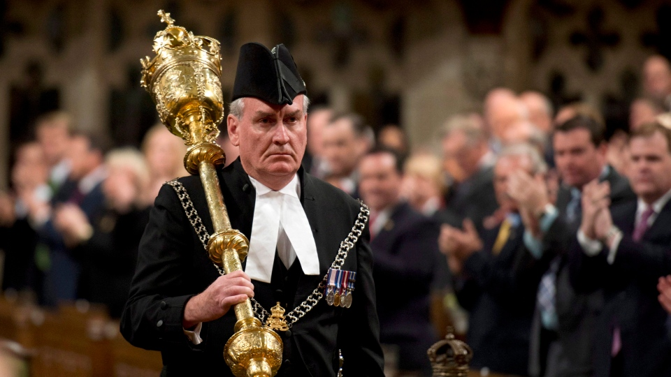Sergeant-at-Arms Kevin Vickers receives a standing ovation as he enters the House of Commons, on Thursday, Oct. 23, 2014. (Adrian Wyld / THE CANADIAN PRESS)
