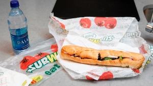 This Aug. 11, 2009, file photo, shows a chicken breast sandwich and water from subway on a kitchen counter in New York. (AP / Seth Wenig)