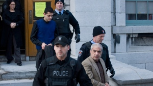 Mohammad Shafia, front, Tooba Yahya, left, and Hamed Shafia, centre, are led from the Frontenac County courthouse in Kingston, Ont., on Jan. 29, 2012. (Graham Hughes / CANADIAN PRESS)
