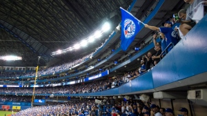 Fans cheer before the start of game one American League Division Series baseball action between the Toronto Blue Jays and Texas Rangers in Toronto on Thursday, Oct. 8, 2015. THE CANADIAN PRESS/Darren Calabrese