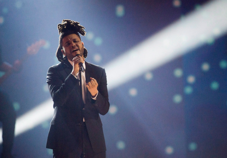 The Weeknd performs during the 2015 Juno Awards in Hamilton, Ont., on March 15, 2015. (Nathan Denette / THE CANADIAN PRESS)