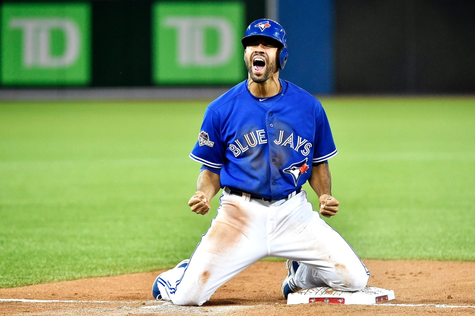 Toronto Blue Jays pinch-runner Dalton Pompey reacts as he's safe at third base during the 7th inning of Game 5 in Toronto on Wednesday, Oct. 14, 2015. (Nathan Denette / THE CANADIAN PRESS)