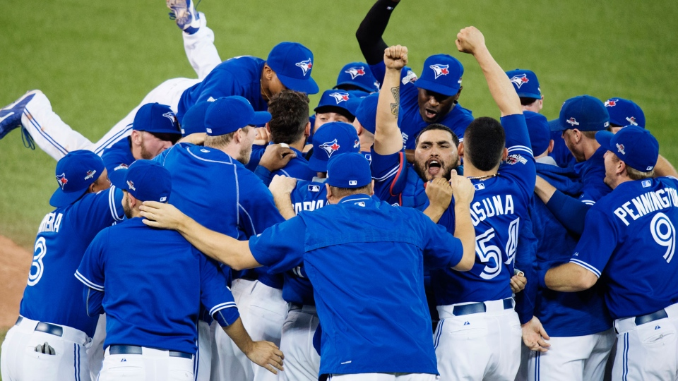 The Toronto Blue Jays celebrate their series win over the Texas Rangers during Game 5 of the ALDS in Toronto, Wednesday, Oct. 14, 2015. (Darren Calabrese / THE CANADIAN PRESS)