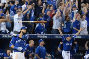 Jose Bautista tosses his bat after hitting a three-run home run in Toronto on Wednesday, Oct. 14, 2015. (Chris Young / THE CANADIAN PRESS)