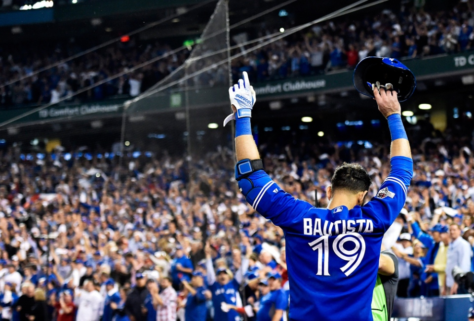 Jose Bautista acknowledges the crowd after hitting a three-run home run against the Texas Rangers during the 7th inning of the ALDS in Toronto on Wednesday, Oct. 14, 2015. (Nathan Denette / THE CANADIAN PRESS)