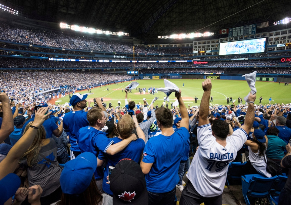 Fans celebrate following the Toronto Blue Jays series win over the Texas Rangers during Game 5 of the ALDS in Toronto on Wednesday, Oct. 14, 2015. (Darren Calabrese / THE CANADIAN PRESS)