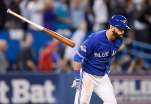 Toronto Blue Jays' Jose Bautista flips his bat after hitting a three-run home run against the Texas Rangers during the seventh inning of game 5 American League Division Series baseball action in Toronto on Wednesday, Oct. 14, 2015. (Frank Gunn / THE CANADIAN PRESS)