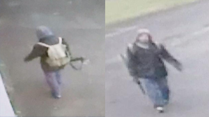 Fredericton Police say this 'person was interest' was actually carrying an umbrella, not a firearm. (Fredericton Police Force)