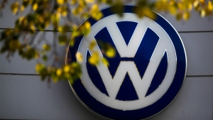 In this Oct. 5, 2015 file photo the VW sign of Germany's car company Volkswagen is displayed at the building of a company's retailer in, Berlin, Germany. (AP Photo/Markus Schreiber)